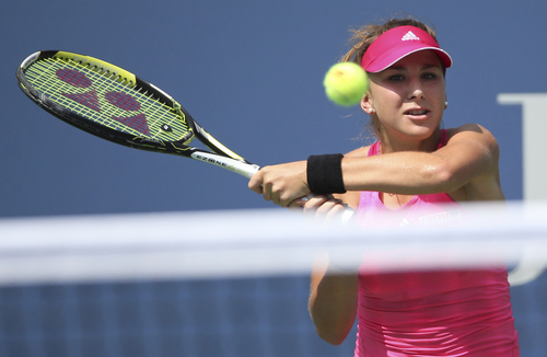 Belinda Bencic, of Switzerland, returns a shot to Peng Shuai, of China, during the quarterfinals of the 2014 U.S. Open tennis tournament, Tuesday, Sept. 2, 2014, in New York. (AP Photo/Mike Groll)
