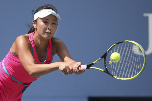 Peng Shuai, of China, returns a shot against Belinda Bencic, of Switzerland, during the quarterfinals of the 2014 U.S. Open tennis tournament, Tuesday, Sept. 2, 2014, in New York. (AP Photo/Mike Groll)