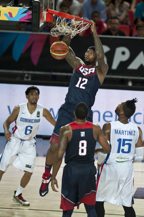 United States's DeMarcus Cousin, center, dunks the ball against Dominican Republic during the Group C Basketball World Cup match, in Bilbao northern Spain, Wednesday, Sept. 3, 2014. The 2014 Basketball World Cup competition take place in various cities in Spain from Aug. 30 to Sept. 14. (AP Photo/Alvaro Barrientos)