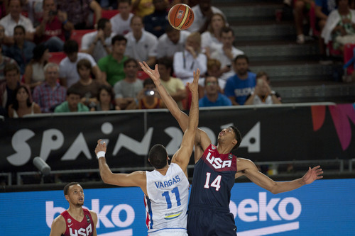 United States's Anthony Davis, right, jumps for the ball with Dominican Republic's Eloy Vargas during the Group C Basketball World Cup match in Bilbao, northern Spain, Wednesday Sept. 3, 2014. The 2014 Basketball World Cup competition take place in various cities in Spain from  Aug. 30 to Sept. 14. (AP Photo/Alvaro Barrientos)