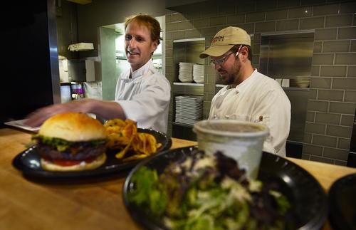Scott Sommerdorf   |  The Salt Lake Tribune Chef/owner Tom Grant, left, and Brandon Mowbray work from the renovated kitchen at Martine restaurant, Friday, Aug. 29, 2014.