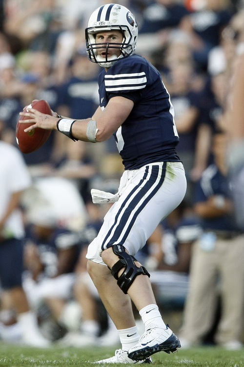 Photo by Chris Detrick  |  The Salt Lake Tribune  Brigham Young's Max Hall #15 looks to pass during the second half of the game at Lavell Edwards stadium Saturday September 26, 2009. BYU won the game 42-23.