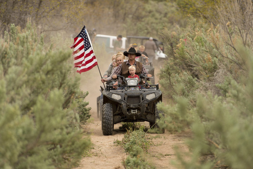 Trent Nelson  |  The Salt Lake Tribune Ryan Bundy, son of the Nevada rancher Cliven Bundy, rides an ATV into Recapture Canyon, which has been closed to motorized use since 2007, after a call-to-action by San Juan County Commissioner Phil Lyman on Saturday, May 10, 2014, north of Blanding.