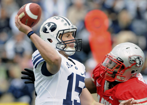 BYU's quarterback  Max Hall throws against the defense of New Mexico during an NCAA college football game on Saturday, Nov. 14, 2009 in Albuquerque, N.M.  BYU defeated New Mexico 24-19.  (AP Photo/Albuquerque Journal, Jim Thompson)