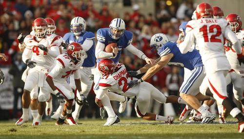 Chris Detrick | The Salt Lake Tribune  BYU quarterback Max Hall (15) is tackled by Utah defensive back Lamar Chapman (21) during the first quarter of the BYU Utah game at Lavell Edwards Stadium in Provo, Utah, Saturday, November 28, 2009.