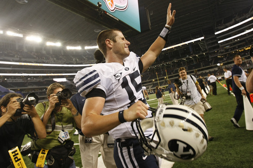 Brigham Young's Max Hall #15 waves to the crowd as he walks off of the field after the game against Oklahoma at Cowboys Stadium Saturday September 5, 2009. BYU won the game 14-13  Photo by Chris Detrick/The Salt Lake Tribune