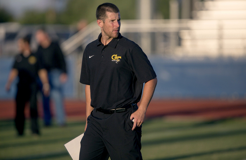 (Patrick Breen  |  The Arizona Republic)  Gilbert's offensive coordinator Max Hall looks over his team before they start a game against Mesquite at Mesquite High School in Gilbert, Ariz., on Thursday, August 28, 2014.