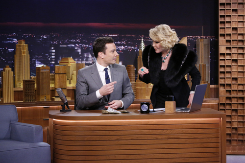 """FILE - In this Monday, Feb. 17, 2014 photo provided by NBC, Joan Rivers appears with Jimmy Fallon during his debut on """"The Tonight Show"""" in New York. Rivers, the raucous, acid-tongued comedian who crashed the male-dominated realm of late-night talk shows and turned Hollywood red carpets into danger zones for badly dressed celebrities,  died Thursday, Sept. 4, 2014. She was 81. Rivers was hospitalized Aug. 28, after going into cardiac arrest at a doctor's office. (AP Photo/NBC, Lloyd Bishop, File)"""