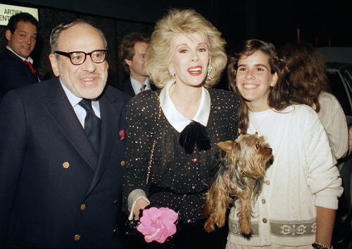 FILE - In this May 16, 1987 file photo shows entertainer Joan Rivers, center, with her husband Edger Rosenberg, left and daughter Melissa, at Fox Broadcasting Studios in Los Angeles. Rivers, the raucous, acid-tongued comedian who crashed the male-dominated realm of late-night talk shows and turned Hollywood red carpets into danger zones for badly dressed celebrities,  died Thursday, Sept. 4, 2014. She was 81. Rivers was hospitalized Aug. 28, after going into cardiac arrest at a doctor's office. (AP Photo/Robert Galbraith, File)