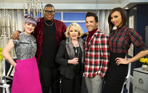 """This image released by E! Entertainment shows, from left, Kelly Osbourne, EJ Johnson, Joan Rivers, George Kotsiopoulos, and Giuliana Rancic on the set of """"Fashion Police."""" Taping for Joan Rivers' E! network show """"Fashion Police"""" has been put on hold, the network confirmed Thursday. Rivers remains hospitalized at Mount Sinai Hospital in New York. Rivers hosts the show and her daughter, Melissa Rivers, is its executive producer.  (AP Photo/E!, Brandon Hickman)"""