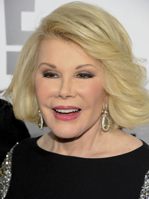 """FILE - In this April 30, 2012 file photo, Joan Rivers attends an E! Network event in New York. Joan Rivers' family said the comedian has been moved from intensive care into a private room, where she is """"being kept comfortable."""" No further details were released Wednesday, Sept. 3, 2014, on Rivers' condition. On Tuesday, the family confirmed she was on life support at Mount Sinai Hospital in Manhattan after going into cardiac arrest last Thursday. (AP Photo/Evan Agostini, File)"""