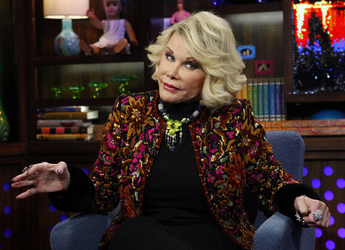 """In this Feb. 16, 2012 photo provided by Bravo, Joan Rivers appears on the """"Watch What Happens Live"""" show in New York. Rivers, the raucous, acid-tongued comedian who crashed the male-dominated realm of late-night talk shows and turned Hollywood red carpets into danger zones for badly dressed celebrities,  died Thursday, Sept. 4, 2014. She was 81. Rivers was hospitalized Aug. 28, after going into cardiac arrest at a doctor's office. (AP Photo/Bravo, Peter Kramer, File)"""