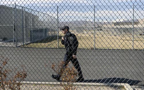 Al Hartmann     The Salt Lake Tribune  Utah Deapertment of Corrections officer patrol the grounds at the Utah State Prison in Draper.