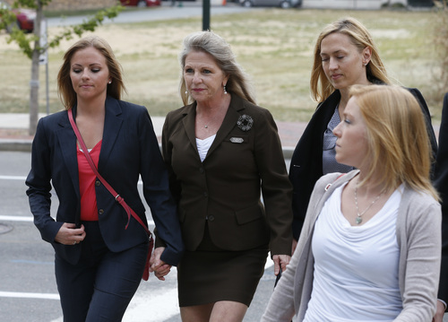 Former Virginia first lady, Maureen McDonnell, second from left, arrives at Federal Court with her daughters,  Rachel McDonnell, left, and Cailin Young, as well as attorney Heather Martin, second from right, prior to the jury's verdict in Richmond, Va., Thursday, Sept. 4, 2014.  Maureen McDonnell, and her husband, former Virginia Gov. Bob McDonnell, were convicted on multiple counts of corruption at Federal Court in Richmond, Va., Thursday, Sept. 4, 2014. A federal jury in Richmond convicted McDonnell on 11 of the 13 counts he faced; Maureen McDonnell was convicted of nine of the 13 counts she had faced. Sentencing was scheduled for Jan. 6.  (AP Photo/Steve Helber)
