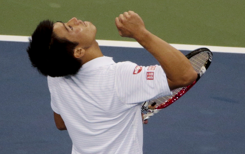 Kei Nishikori, of Japan, reacts after defeating Stan Wawrinka, of Switzerland, in five sets during the quarterfinals of the 2014 U.S. Open tennis tournament, Wednesday, Sept. 3, 2014, in New York. (AP Photo/Julio Cortez)