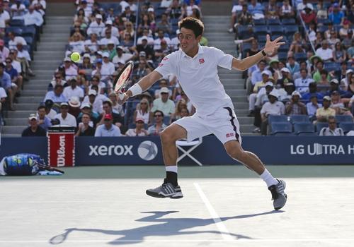 Kei Nishikori, of Japan, returns a shot against Stan Wawrinka, of Switzerland, during the quarterfinals of the 2014 U.S. Open tennis tournament, Wednesday, Sept. 3, 2014, in New York. (AP Photo/Mike Groll)