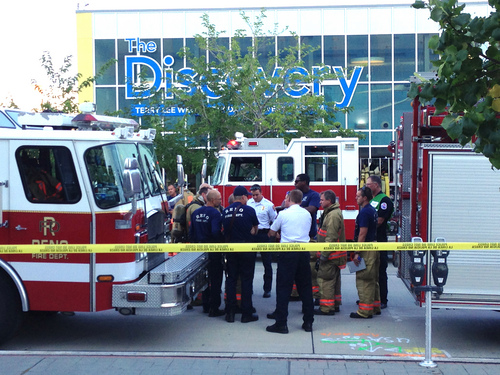 Firefighters confer out side the Nevada Disvory Museum in Reno, Nev., Wednesday Sept. 3, 2014. A minor explosion during a science experiment at the museum burned several children and forced the evacuation of the museum..   (AP Photo/Scott Sonner).