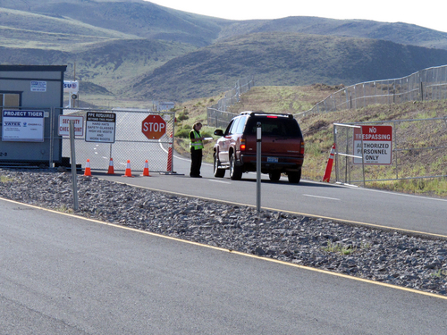 "A guard stops a vehicle at the security checkpoint to enter the site at the Tahoe Reno Industrial Center 15 miles east of Sparks, Nev., Thursday, Sept. 4, 2014. Tesla Motors Inc. plans to build a 6,500 worker ""gigafactory"" to mass produce cheaper lithium batteries for its next line of more-affordable electric cars. (AP Photo/Scott Sonner)"