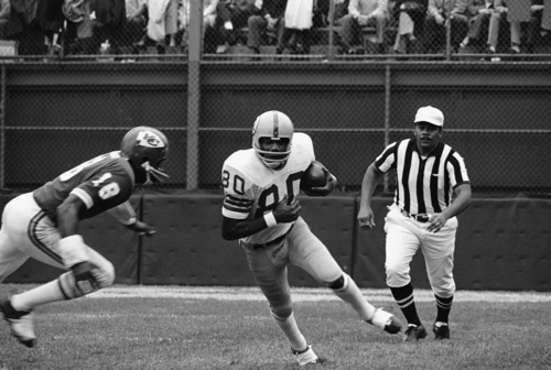 Washington's Roy Jefferson, (80) goes for the first down after taking a pass from quarterback Bill Kilmer. Moving in for the tackle is Kansas City's Emmitt Thomas on Oct. 24, 1971 in Kansas City. (AP Photo/WPS)