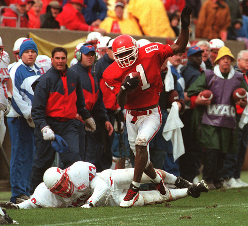 Rick Egan  |  Tribune file photo Kevin Dyson tries to stay in bounds after a big punt return.