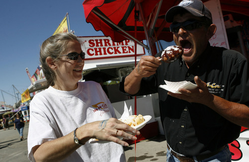 Tribune file photo Lynda and David Wardle of West Valley dig in to a funnel cake and fried peanut butter and jelly sandwich at Utah State Fair in 2008.