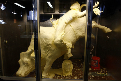 Tribune file photo A butter bull and rider sculpture at a past Utah State Fair.