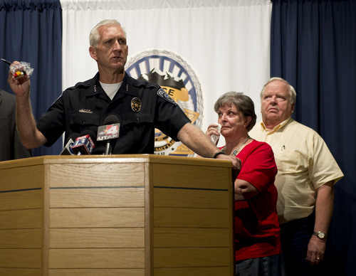 Lennie Mahler  |  The Salt Lake Tribune Salt Lake County Sheriff Jim Winder speaks to the press as siblings Shirley England and Jerold Johnson, right, listen. Unified police believe they solved the 1991 cold-case murder of their mother, Lucille Johnson. Winder holds a bag of Legos like the ones found at the crime scene. Thursday, Aug. 28, 2014.