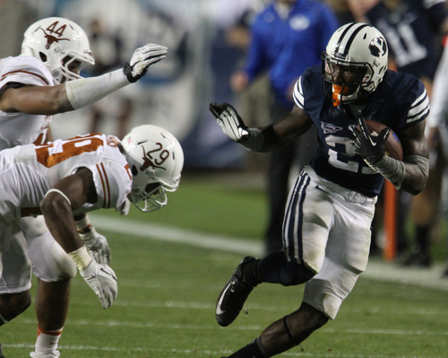 Rick Egan  | The Salt Lake Tribune    Brigham Young Cougars running back Jamaal Williams (21) gets past Texas Longhorns defensive back Sam Moeller (44) and Texas Longhorns defensive back Deshazor Everett (29) as BYU played the University of Texas, Lavell Edwards stadium, Saturday, September 7, 2013.