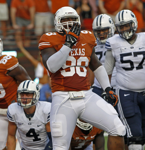 Texas defensive lineman Hassan Ridgeway (98) celebrates a sack of BYU quarterback Taysom Hill during the second quarter of an NCAA college football game in Austin, Texas, Saturday,  Sept. 6, 2014.  (AP Photo/Michael Thomas)