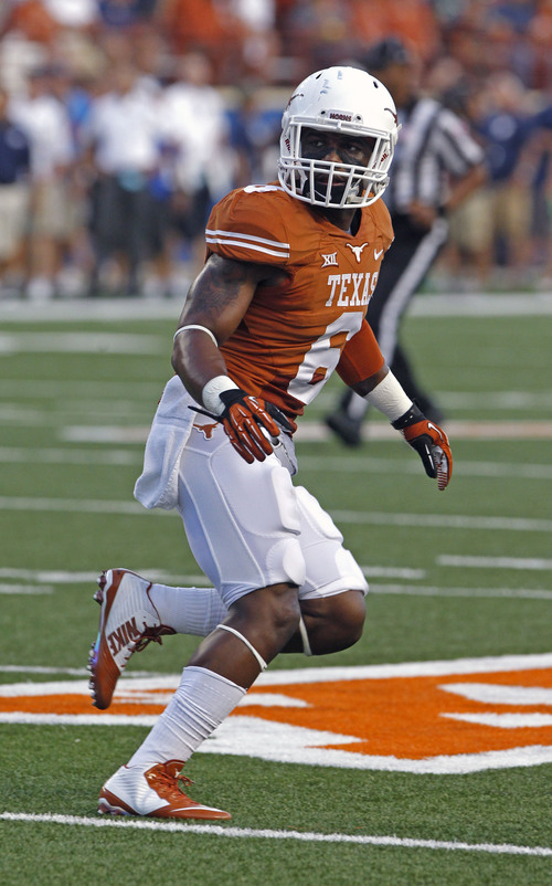 Texas cornerback Quandre Diggs drops into pass coverage during the second quarter of an NCAA college football game against BYU in Austin, Texas, Saturday,  Sept. 6, 2014.  (AP Photo/Michael Thomas)