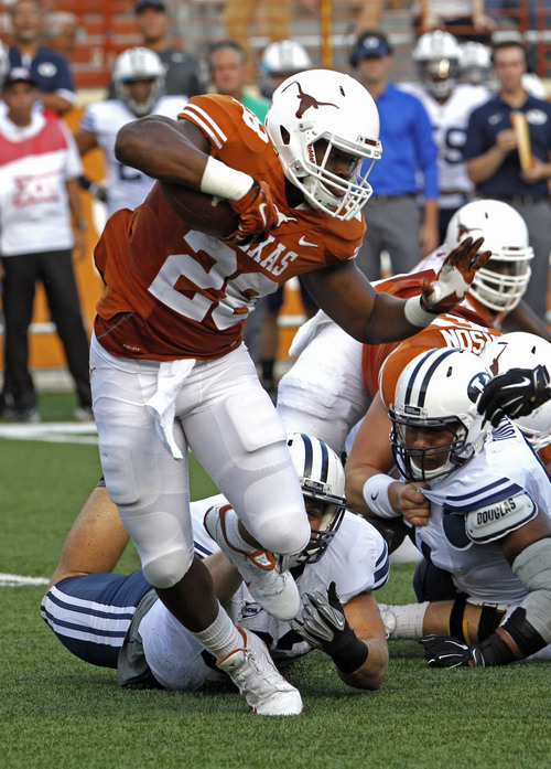 Texas running back Malcolm Brown (28) runs the ball during the first quarter of an NCAA college football game against BYU in Austin, Texas, Saturday,  Sept. 6, 2014.  (AP Photo/Michael Thomas)