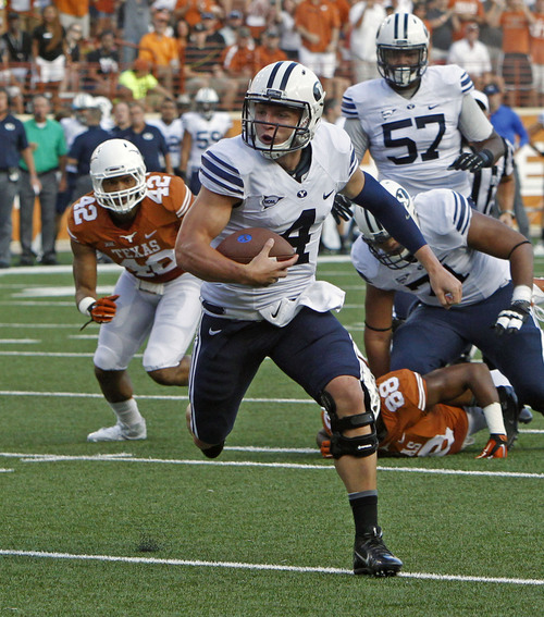 BYU quarterback Taysom Hill runs the ball during the first quarter of an NCAA college football game against Texas in Austin, Texas, Saturday,  Sept. 6, 2014.  (AP Photo/Michael Thomas)