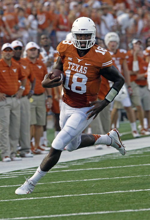 Texas quarterback Tyrone Swoopes runs the ball during the first quarter of an NCAA college football game against BYU in Austin, Texas, Saturday,  Sept. 6, 2014.  (AP Photo/Michael Thomas)