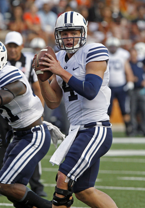 BYU quarterback Taysom Hill looks to pass during the first quarter of an NCAA college football game against Texas in Austin, Texas, Saturday,  Sept. 6, 2014.  (AP Photo/Michael Thomas)