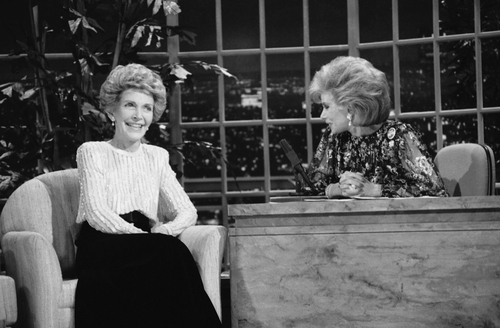 """FILE - In this Oct. 30, 1986 file photo, talk show host Joan Rivers, right, talks with guest, first lady Nancy Reagan, during her appearance on """"The Late Show Starring Joan Rivers,"""" in Los Angeles.  In October 1986, Rivers made TV history as the first woman hosting a late-night broadcast talk show. She was the first face of the Fox network, headlining its first program, """"The Late Show Starring Joan Rivers."""" She died Thursday, Sept. 4, 2014. She was 81. Rivers was hospitalized Aug. 28, after going into cardiac arrest at a doctor's office. (AP Photo, Reed Saxon, File)"""