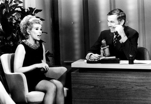 """This undated image released by NBC shows comedian Joan Rivers, left, and host Johnny Carson during """"The Tonight Show Starring Johnny Carson,"""" in Burbank, Calif.  In October 1986, Rivers made TV history as the first woman hosting a late-night broadcast talk show. She was the first face of the Fox network, headlining its first program, """"The Late Show Starring Joan Rivers."""" She died Thursday, Sept. 4, 2014. She was 81. Rivers was hospitalized Aug. 28, after going into cardiac arrest at a doctor's office.  (AP Photo/NBC)"""