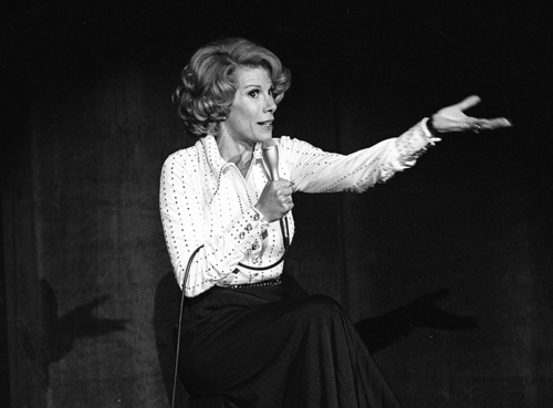 """In this Aug. 13, 1975 photo released by the Las Vegas News Bureau, comedian Joan Rivers performs at the MGM in Las Vegas, Nev.  In October 1986, Rivers made TV history as the first woman hosting a late-night broadcast talk show. She was the first face of the Fox network, headlining its first program, """"The Late Show Starring Joan Rivers."""" She died Thursday, Sept. 4, 2014. She was 81. Rivers was hospitalized Aug. 28, after going into cardiac arrest at a doctor's office. (AP Photo/Las Vegas News Bureau)"""
