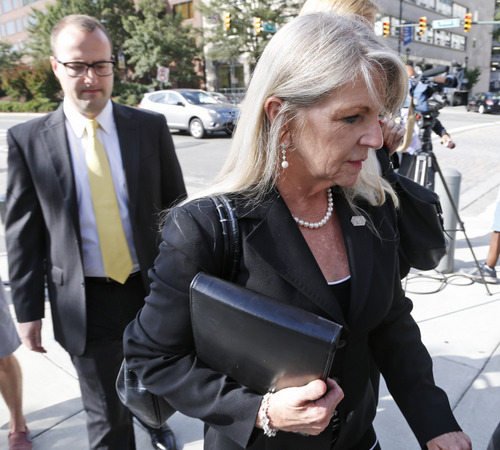 FILE - In this Sept. 2, 2014 file photo, former Virginia first lady Maureen McDonnell, right, arrives at Federal Court after the first day of jury deliberations in her corruption trial in Richmond, Va. Now that the guilty verdicts on public corruption are in, attention turns to the McDonnells' Jan. 6 sentencing and subsequent appeal. (AP Photo/Steve Helber, File)