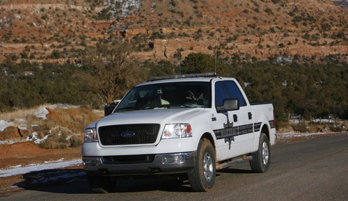 Trent Nelson  |  Tribune file photo A Hildale/Colorado City marshal patrols in Hildale, Utah, in 2006.