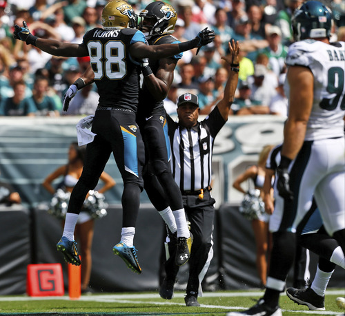Jacksonville Jaguars' Allen Hurns (88) and Marqise Lee (11) celebrate after Hurns' touchdown during the first half of an NFL football game against the Philadelphia Eagles, Sunday, Sept. 7, 2014, in Philadelphia. (AP Photo/Michael Perez)