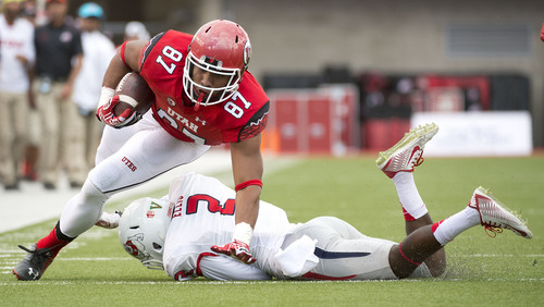 Jeremy Harmon  |  The Salt Lake Tribune  Utah's Siale Fakailoatonga (87) is tackled by DUPLICATE***Fresno State's Jamal Ellis (2) as the Utes host the Bulldogs at Rice-Eccles Stadium on Saturday, Sept. 6, 2014.