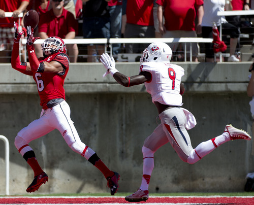 Jeremy Harmon  |  The Salt Lake Tribune  Utah's Dres Anderson (6) catches a pass for a touchdown while pursued by Fresno State's Curtis Riley (9) as the Utes host the Bulldogs at Rice-Eccles Stadium on Saturday, Sept. 6, 2014.