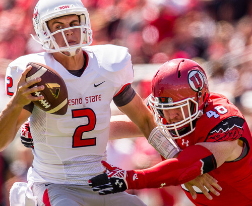 Trent Nelson  |  The Salt Lake Tribune Utah Utes defensive end Hunter Dimick (49) sacks of Fresno State Bulldogs quarterback Brian Burrell (2) as Utah hosts Fresno State, college football at Rice-Eccles Stadium Saturday September 6, 2014.