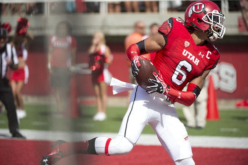 Jeremy Harmon  |  The Salt Lake Tribune  Utah's Dres Anderson (6) catches the ball for a touchdown as the Utes host the Bulldogs at Rice-Eccles Stadium on Saturday, Sept. 6, 2014.