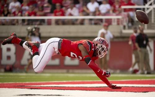 Jeremy Harmon  |  The Salt Lake Tribune  Utah's Kenric Young (24) just misses a pass in the end zone as the Utes host the Bulldogs at Rice-Eccles Stadium on Saturday, Sept. 6, 2014.