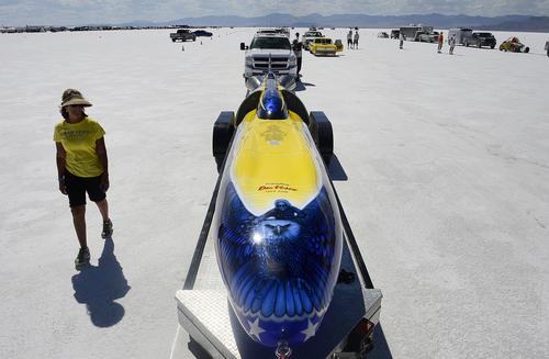 "Scott Sommerdorf   |  The Salt Lake Tribune Team member Jinx Vesco walks by the ""Turbinator II"" as they wait in line at the Utah Salt Flats Racing Association World of Speed, Sunday, September 7, 2014."