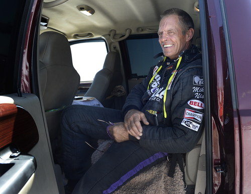 Scott Sommerdorf   |  The Salt Lake Tribune Driver Mike Nish sits in the cab of the team's truck as they wait in line for their turn to make an attempt at the Utah Salt Flats Racing Association World of Speed, Sunday, September 7, 2014. The car had to cut it's first run short due to a mechanical issue.