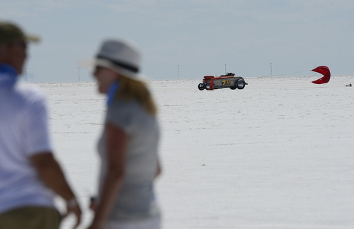 "Scott Sommerdorf   |  The Salt Lake Tribune Chet Thomas pulls his 'chute as he turns off the course after an engine failure on his ""Grass Valley Roadster"" at the Utah Salt Flats Racing Association World of Speed, Sunday, September 7, 2014. Thomas is from Grass Valley, California."