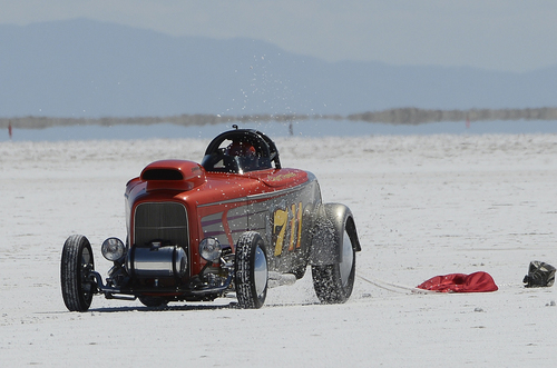 "Scott Sommerdorf   |  The Salt Lake Tribune Chet Thomas pulls off the course after an engine failure on his ""Grass Valley Roadster"" at the Utah Salt Flats Racing Association World of Speed, Sunday, September 7, 2014. Thomas is from Grass Valley, California."