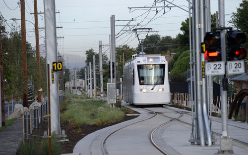 Al Hartmann  |  The Salt Lake Tribune  The Sugar House streetcar nears the end of the line at Fairmont Park Wednesday August 13, 2014.  It is only slightly faster than the nearby parallel bus, and pedestrians sometimes can outrace it. Far fewer people than projected are riding it. And it was expensive, $37 million. But officials still see it as a success and worth the price because of the economic development it has attracted.